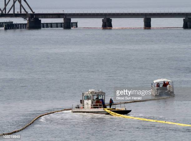 Workers deploy oil containment booms in the Bay of St Louis in Biloxi Mississippi on Wednesday May 19 2010 The containment booms are being put out to...