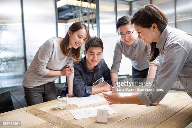 it workers developing smart phone - visual china group stock pictures, royalty-free photos & images