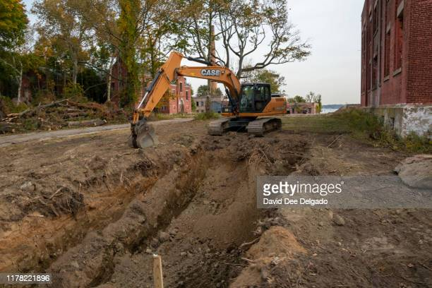 Workers dig a trench that will eventually becoome a mass grave on Hart Island a former prison and Nike missile silo site which is now the largest...