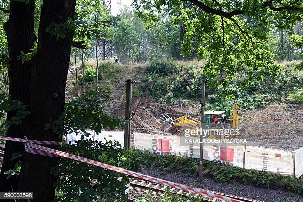 Workers dig the ground as excavations are under way aiming to verify the existence of the socalled 'Nazi Gold train' in Walbrzych Poland on August 16...