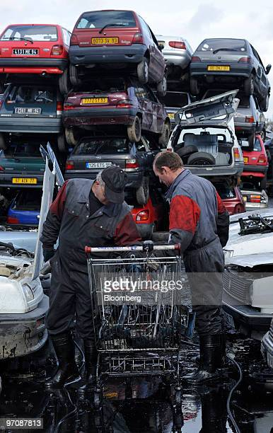 Workers disassemble damaged cars at Allo Casse Auto's car demolition site in Athis Mons France on Wednesday Feb 24 2010 French consumer spending...