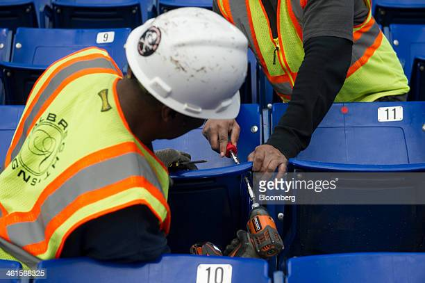Workers disassemble stadium seating during the demolition of the Hubert H Humphrey Metrodome in Minneapolis Minnesota US on Tuesday Jan 7 2014 The...