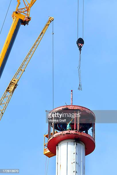 Workers disassemble the Astrotower in Coney Island on July 4 2013 in the Brooklyn borough of New York City Officials decided to close Luna Park and...