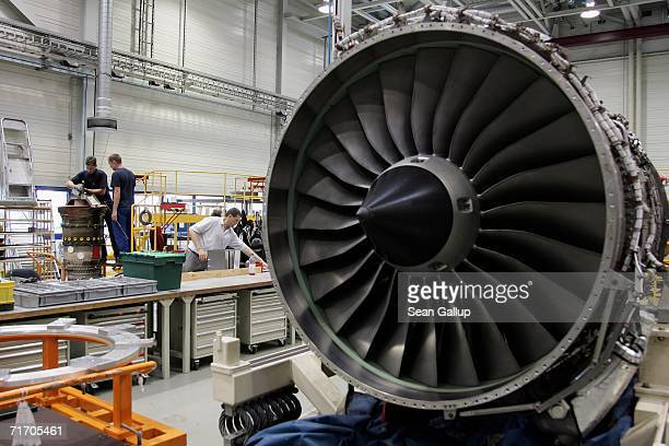 Workers disassemble the core of an aircraft jet engine requiring refurbishing August 23 2006 at the RollsRoyce aircraft engine factory in Berlin...