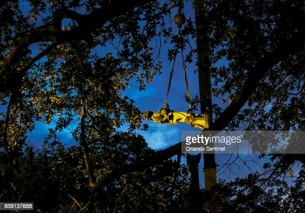 Workers disassemble the quotJohnny Rebquot Confederate memorial statue at Lake Eola Park on Tuesday morning June 20 2017 The statue will later be...