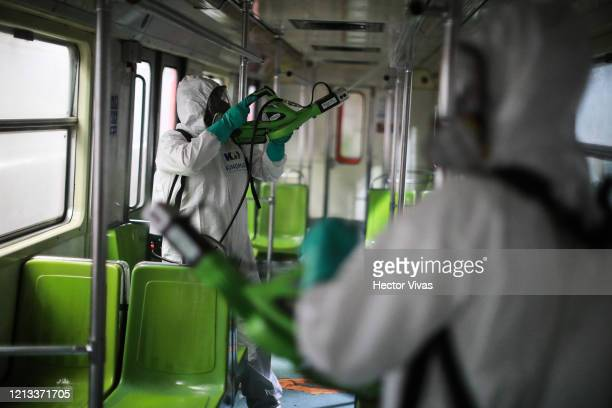 Workers disinfect a metro train car during a cleaning day at Coordinación de Mantenimiento Mayor Ticoman Coach Yard on March 18 2020 in Mexico City...