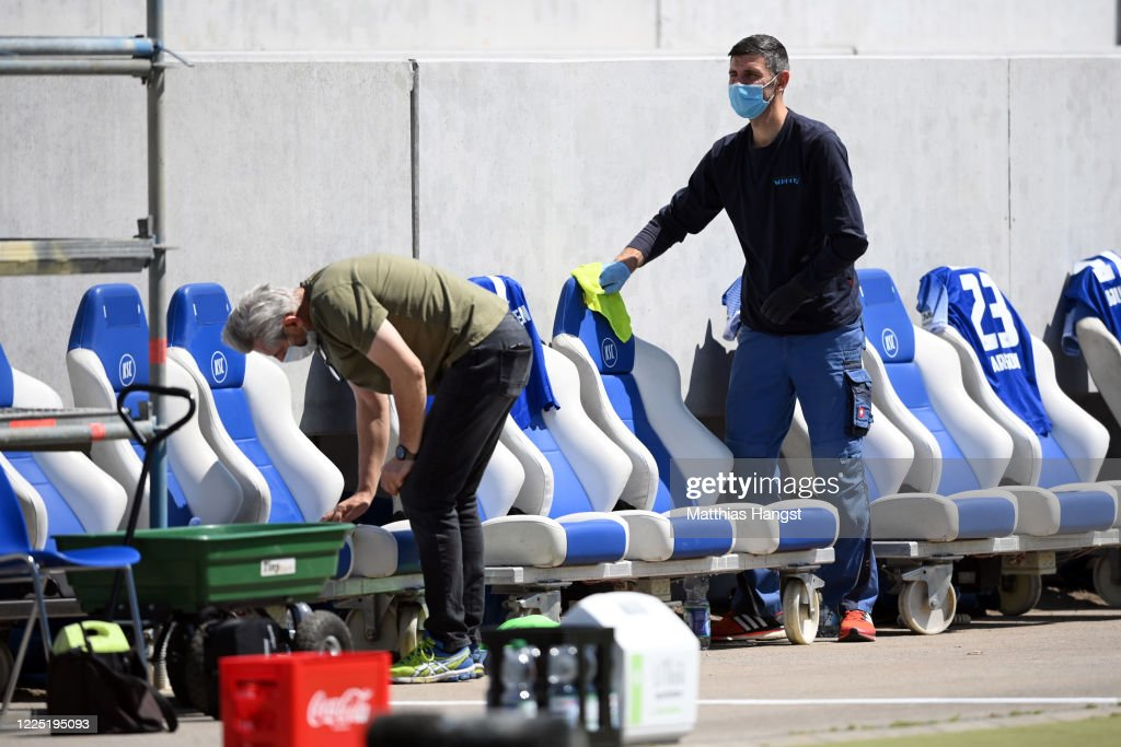 Workers disinfect the Karlsruhe team bench at half during the ...