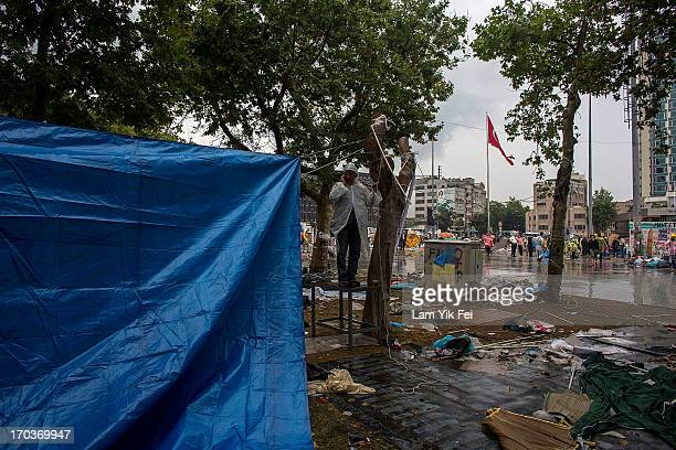 Workers dismantle a protestors's camp at Gezi Park the morning after a police crackdown on protesters on June 12 2013 in Istanbul Turkey Istanbul has...