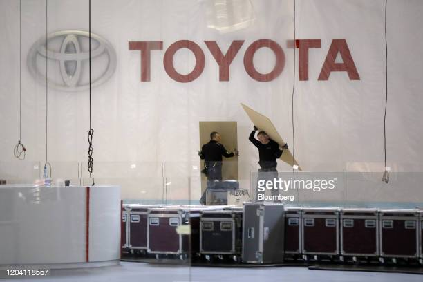 Workers dismantle a Toyota Motor Corp. Pavilion at Palexpo, the venue for the cancelled Geneva International Motor Show in Geneva, Switzerland, on...