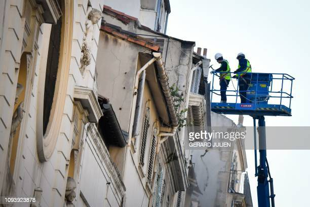 Workers dismantle endangered building on de la Palud's street in Marseille southern France on February 5 2019 Three months after the collapse of two...