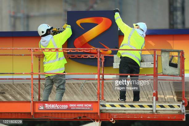 Workers dismantle part of a Z petrol station on April 28, 2020 in Wellington, New Zealand. New Zealand's lockdown measures have eased slightly as the...
