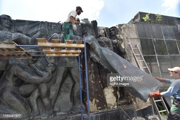Workers dismantle parts of the bas-relief in the form of a woman at the Monument of Glory in Lviv. Work on the liquidation of the Soviet complex of...