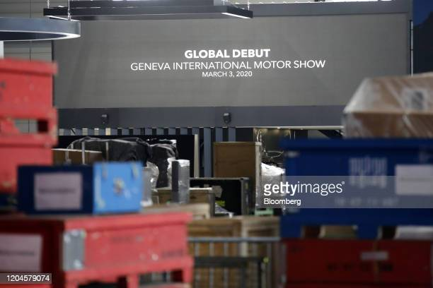 Workers dismantle stalls at Palexpo, the venue for the cancelled Geneva International Motor Show in Geneva, Switzerland, on Saturday, Feb. 29, 2020....