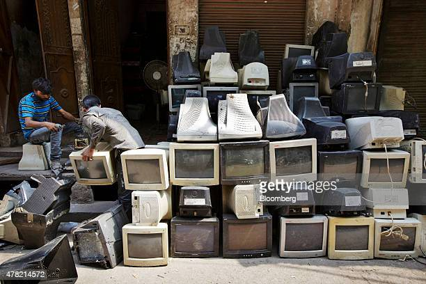 Workers dismantle used computer monitors by the side of a road in New Delhi India on Thursday Thursday June 18 2015 The rupee climbed 08 percent in...