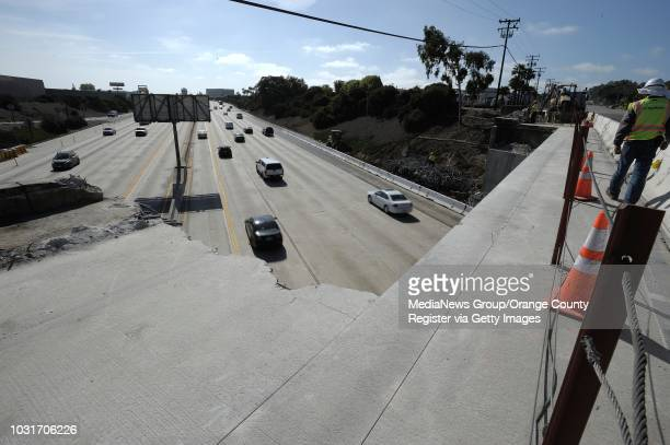 Workers dismantled part of the north bound Temple Avenue bridge where it crosses the San Diego Freeway over the weekend in Long Beach. Work is being...