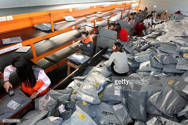 Workers distribute express parcels at a logistics centre of Shentong Express during Alibaba Group's Singles' Day global shopping festival on November...