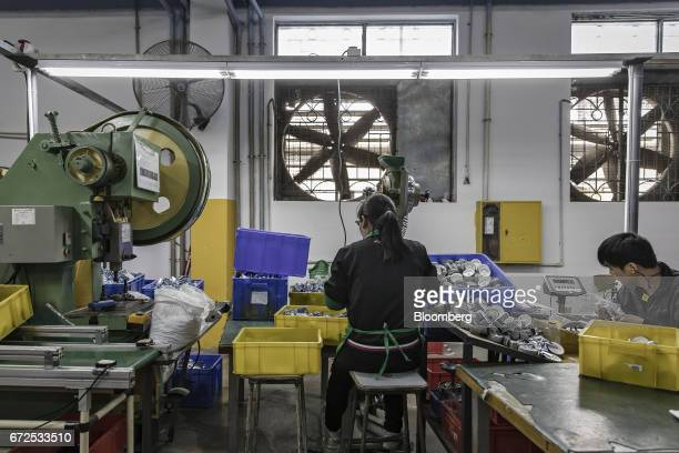 Workers drill and sort casters at a factory operated by the Guangdong Shiyi Furniture Co in Foshan China on Tuesday Feb 28 2017 Startup EDeodar a...
