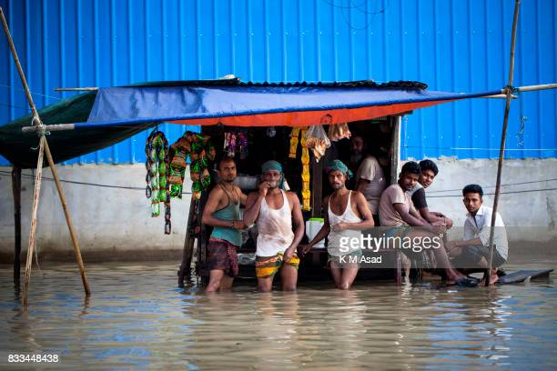 AGRABAD DHAKA CHITTAGONG BANGLADESH Workers drinking tea in a flooded area of Chittagong Chittagong city is facing unprecedented flooding this year...