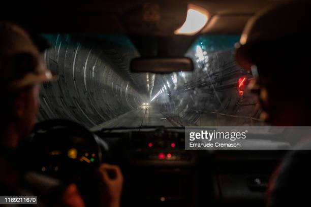 Workers drive a van at the construction site for the main base tunnel of the TurinLyon highspeed railway on August 20 2019 in Saint Martin de la...