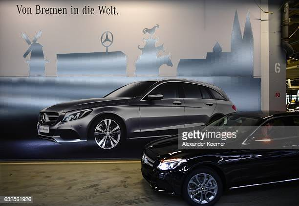 A workers drives a finished of MercedesBenz CClass car through production on January 24 2017 in Bremen Germany Daimler AG which owns Mercedes is...