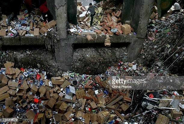 Workers dump shoddy products into rubbish facilities on March 9 2007 in Shenzhen of Guangdong Province China Shoddy products worth more than 200...