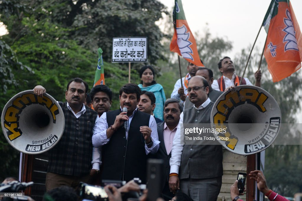 BJP workers during a protest against Aam Aadmi Party at CM Residence in New Delhi.