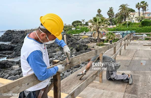 Workers during the restoration of a bathing establishment after the safety measures against Covid19 to be followed for 'phase 2' have been...