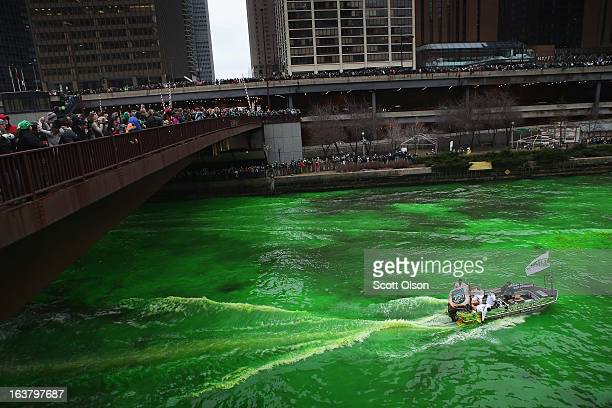Workers dye the Chicago River green to kick off the city's St Patrick's day celebration on March 16 2013 in Chicago Illinois The dying of the river...