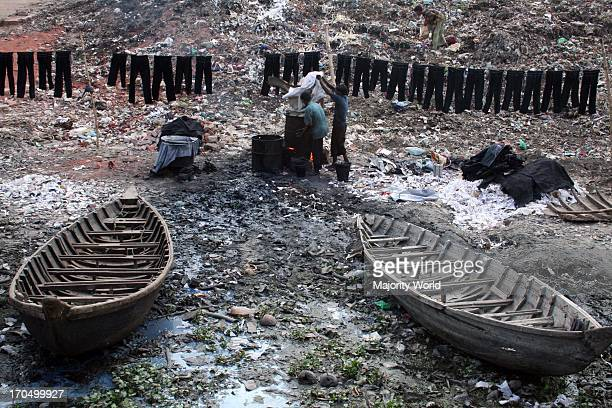 Workers dyeing clothes by the side of Buriganga river This poses a serious threat to the ecosystem but illegal traders resume their activities along...