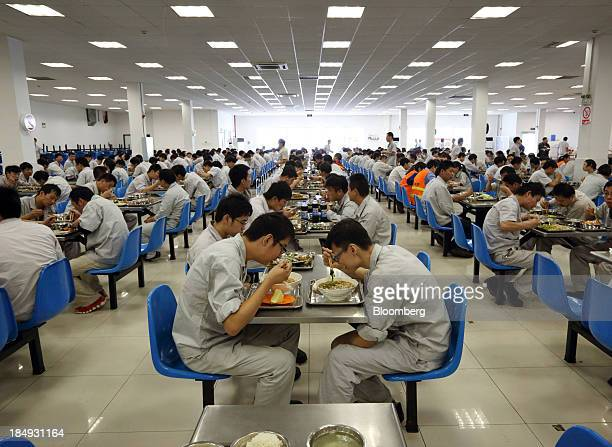 Workers eat in a cafeteria during lunch hour at a plant operated by Dongfeng PeugeotCitroen Automobile Ltd the joint venture between Dongfeng Motor...