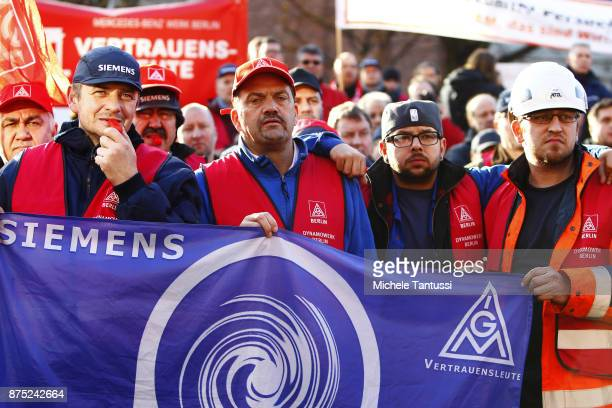 Workers employed by German engineering company Siemens protest pending layoffs in front of the Siemens dynamo factory on November 17 2017 in Berlin...