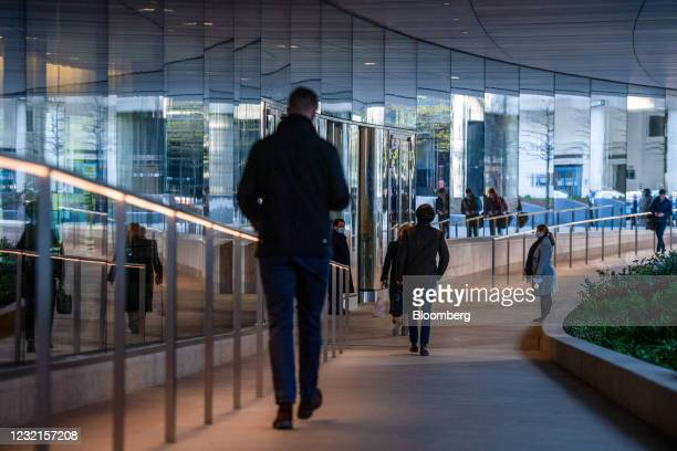Workers enter the European headquarters of Goldman Sachs Group Inc. In London, U.K., on Wednesday, April 7, 2021. Hundreds more JPMorgan Chase & Co....