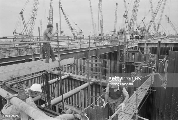 Workers erect a cofferdam during construction of the Thames Flood Barrier on the River Thames London August 1976