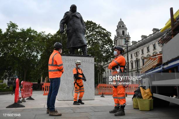 Workers erect a protective barrier around the statue of Winston Churchill in Parliament Square in anticipation of protests tomorrow on June 11 2020...