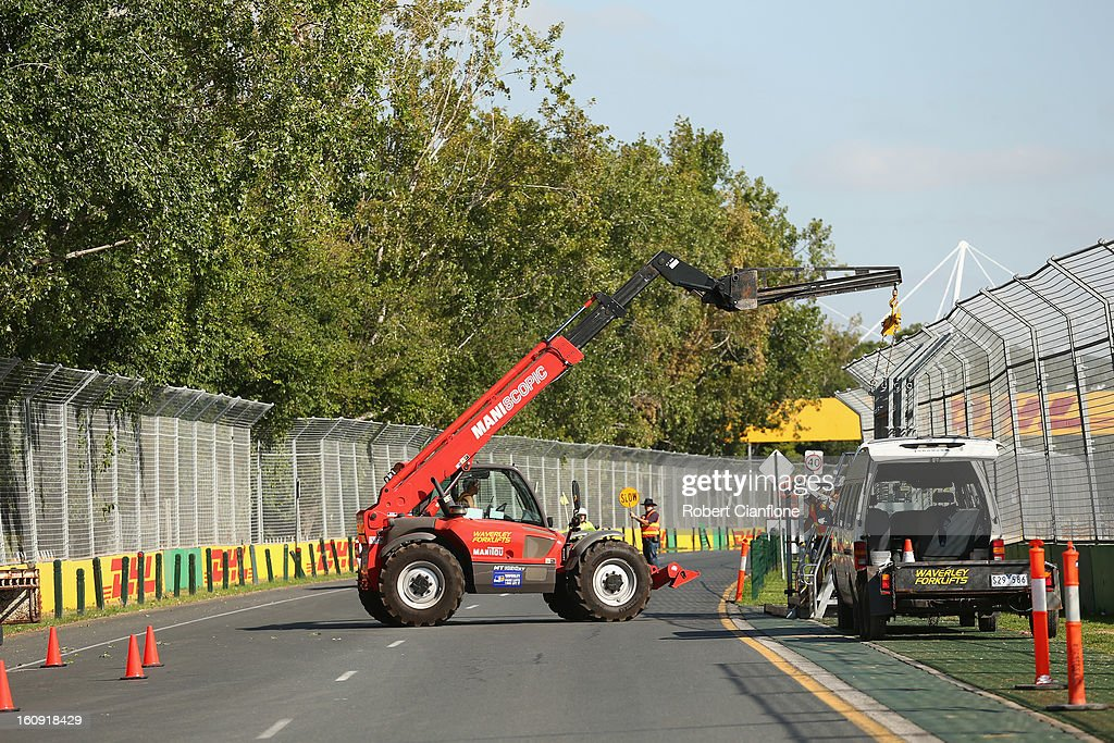 Workers erect safety barriers as the circuit is prepared for the Australian Formula One grand Prix at Albert Park, on February 8, 2013 in Melbourne, Australia.