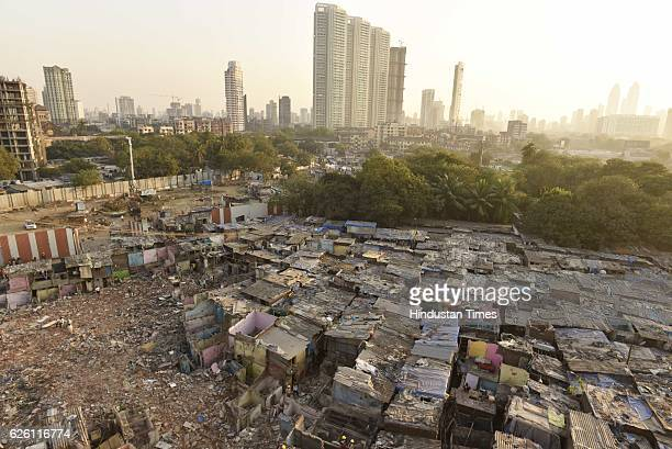 Workers evacuate the debris as nearly 800 slums demolished within a single day with Mahalaxmi's iconic Dhobi Ghat all set for a makeover through SRA...