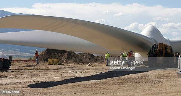 Workers examine the rotor before it is installed on wind generator tower A instillation of four towers are being erected alongside Interstate 25 ten...