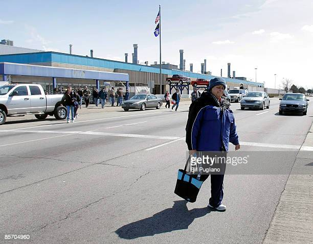 Workers exit from the DaimlerChrysler Warren Truck Assembly Plant part of the Dodge City Complex March 30 2009 in Warren Michigan Today President...