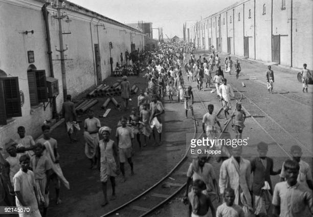 Workers exiting for lunch hour at the Birla Jute Mill in Calcutta , India, 1929.