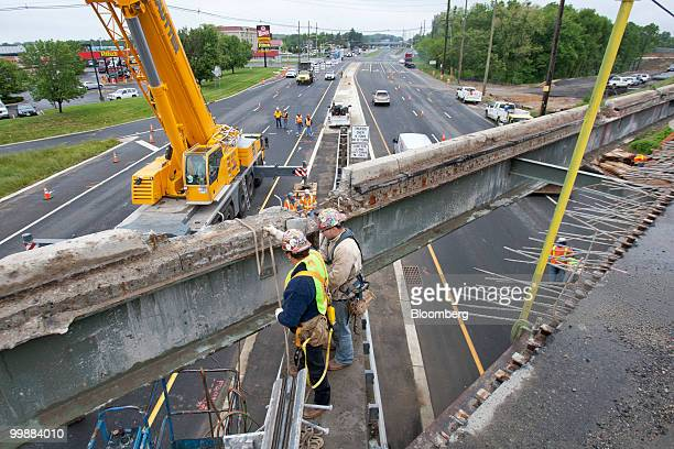 Workers extend an overpass on the New Jersey Turnpike in Bordentown New Jersey US on Wednesday May 12 2010 New Jersey the thirdmost indebted US state...