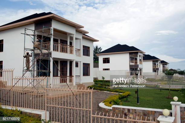 Workers finish a newly constructed exclusive housing community called Kagarama Estate on November 8 2014 in Kicukiro outside Kigali Rwanda The...