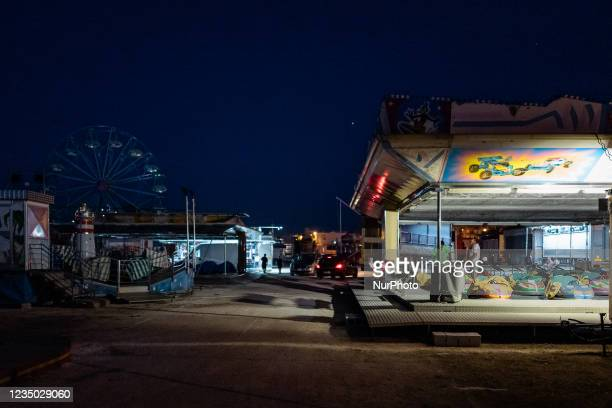 Workers finish cleaning the carousel after assembly at the Luna Park at Secca dei Pali in Molfetta, on 2 September 2021. On the occasion of the...