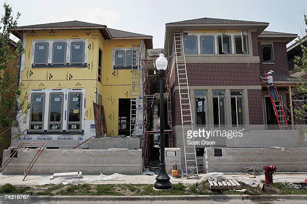 Workers finish construction on a series of singlefamily homes in a development on the city's near south side May 24 2007 in Chicago Illinois Sales of...