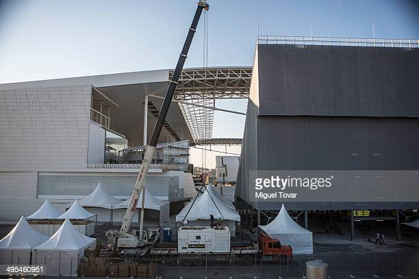 Workers finish the last details on the Arena Corinthians Stadium on June 03 2014 in Sao Paulo Brazil Sao Paulo will be hosting FIFA 2014 World Cup...