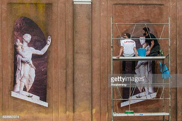 Workers finish to prepare their installation at the 15th Architecture Venice Biennale area on May 24 2016 in Venice Italy The 56th International...