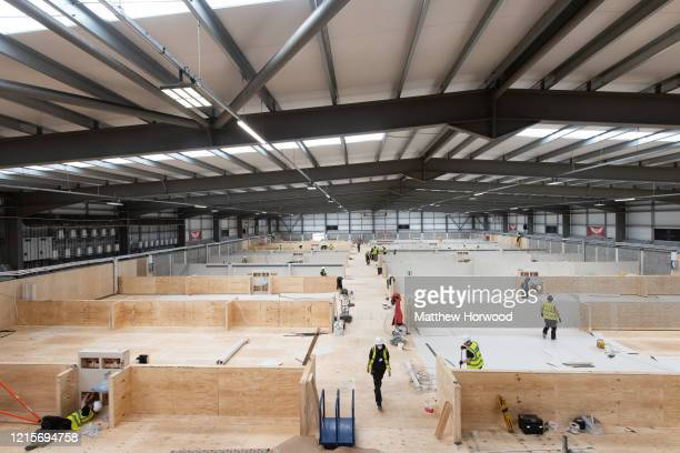Workers fit out the indoor training centre at Parc y Scarlets as a field hospital on March 30 in Llanelli, Wales. Parc y Scarlets, home of Scarlets...