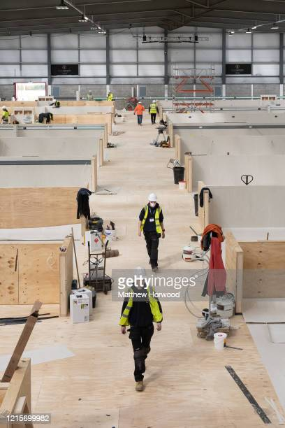 Workers fit out the indoor training centre at Parc y Scarlets as a field hospital on March 30 in Llanelli Wales Parc y Scarlets home of Scarlets and...