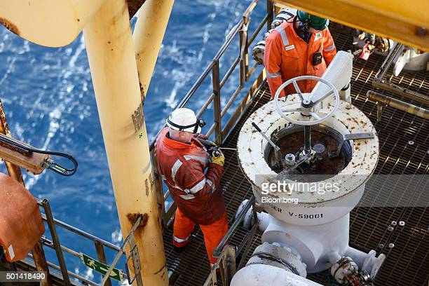 Workers fix a pig launcher on the Armada gas condensate platform operated by BG Group Plc in the North Sea off the coast of Aberdeen UK on Thursday...