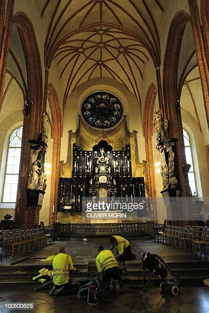 Workers fix some steps for renovation in the Cathedral known as Storkyrkan situated near the Royal Castle in Stockholm on May 25 less than a month...