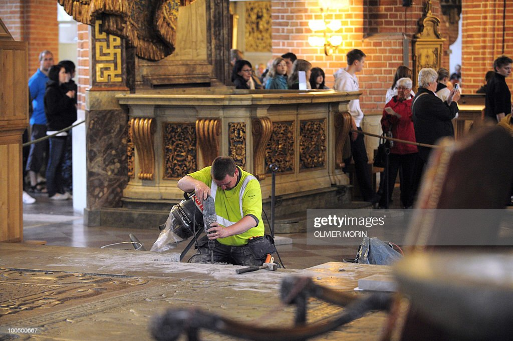 A workers fixes some steps for renovation as visitors walk into the Cathedral, known as Storkyrkan, situated near the Royal Castle in Stockholm on May 25, 2010, less than a month before Crown Princess Victoria 's wedding, the 32-year-old eldest daughter of King Carl XVI Gustaf. Tensions with the archbishop, the future prince's health problems and the soaring cost of the festivities are just some of the controversies surrounding the run-up to Swedish Crown Princess Victoria and her husband-to-be Daniel Westling's June 19 wedding.